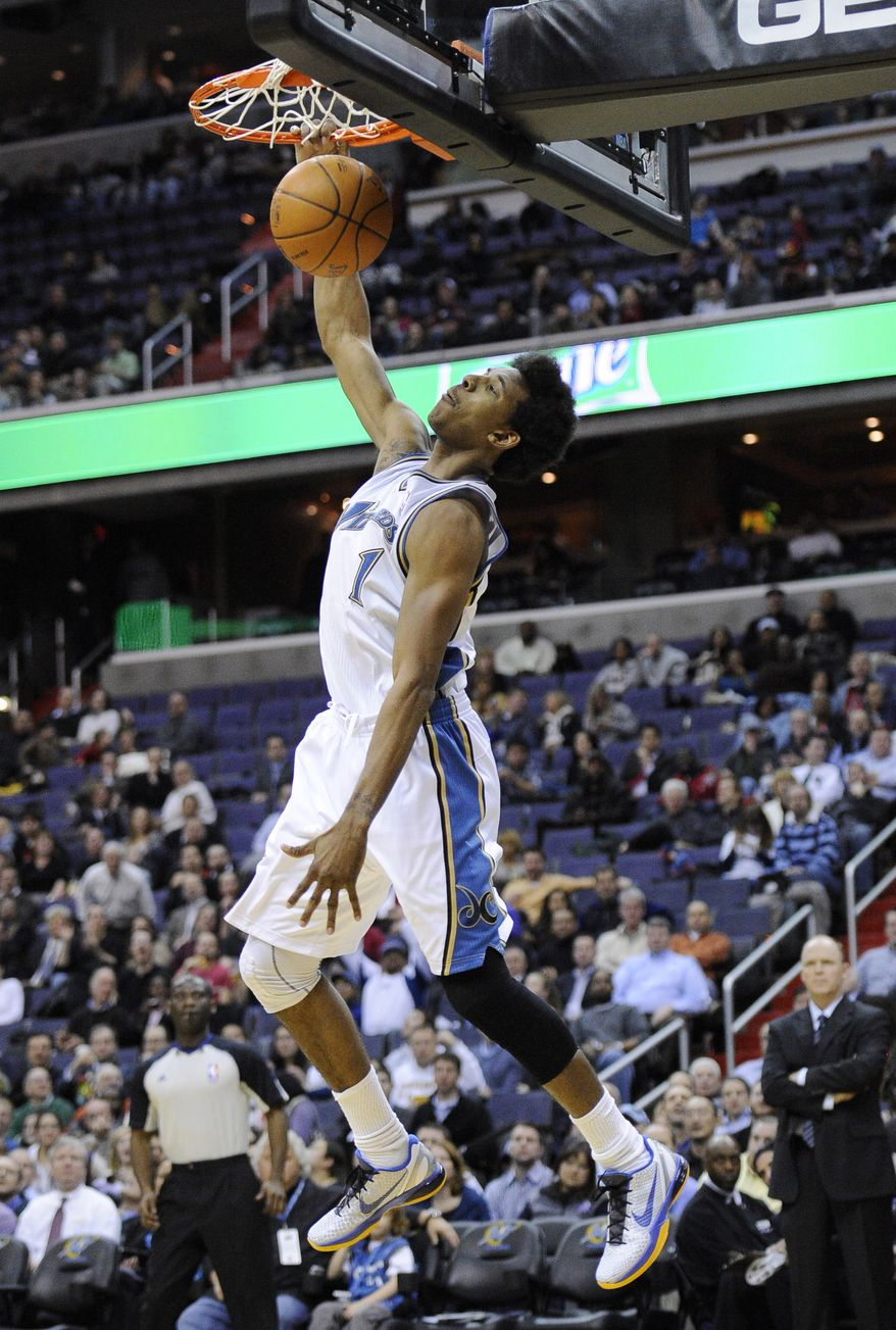 Washington Wizards guard Nick Young dunks during the second half of an NBA basketball game against the Milwaukee Bucks, Wednesday, Feb. 9, 2011, in Washington. The Wizards won 100-85. (AP Photo/Nick Wass)