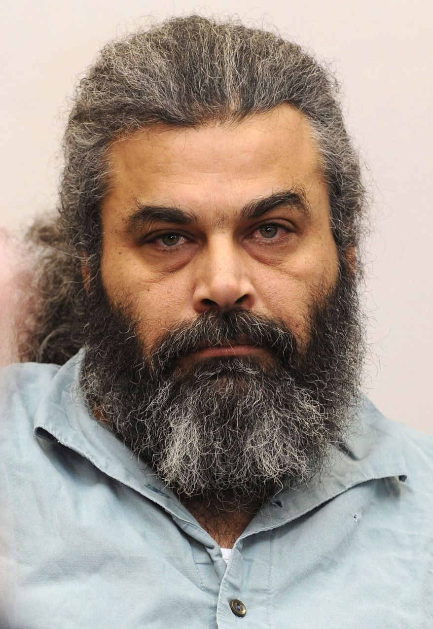** FILE ** In this March 30, 2010, file photo, Khaled el-Masri waits for the verdict in a courtroom of the court in Memmingen, southern Germany. In the years since the Sept. 11 attacks, CIA officers who committed serious mistakes that left people wrongly imprisoned or even dead have received only minor admonishments or no punishment at all, according to an Associated Press investigation. (AP Photo/dapd, Felix Kaestle, File)