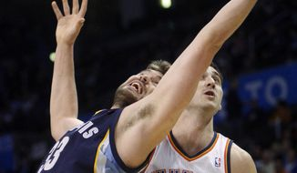 Memphis Grizzlies center Marc Gasol, left, of Spain, stretches to grab a rebound in front of Oklahoma City Thunder center Nenad Krstic, right, of Serbia, in the first quarter of an NBA basketball game in Oklahoma City, Tuesday, Feb. 8, 2011. (AP Photo/Sue Ogrocki)