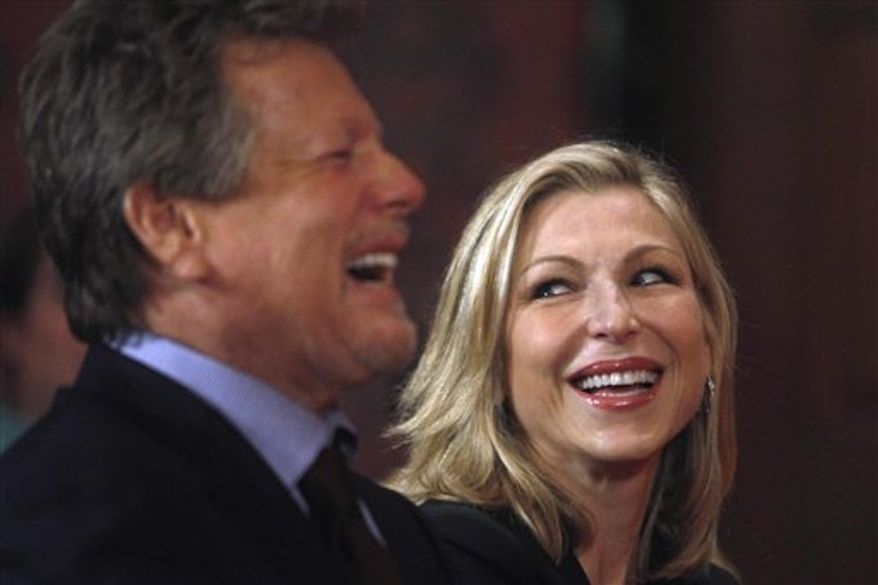FILE - In this Feb. 2, 2011 file photo, actor Ryan O'Neal, left, and his actress daughter Tatum O'Neal laugh at the Smithsonian's National Museum of American History, in Washington, during a ceremony where objects from the private collection of Farrah Fawcett's estate were donated. The actors are filming a reality show for Oprah Winfrey's OWN network with the hope of further mending their relationship that was in tatters for 20 years until they reunited at Fawcett's funeral in 2009. O'Neal says the series was Tatum's idea and she had to talk him into it. (AP Photo/Jacquelyn Martin, File)