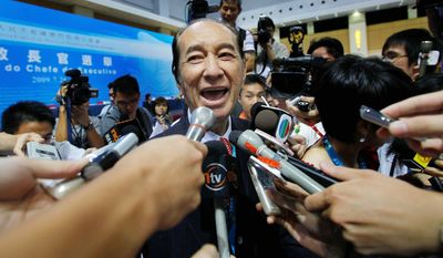 Stanley Ho, seen in July 2009, is father of Macau's gambling industry, the world's largest, and has a vast collection of other businesses. (Associated Press)