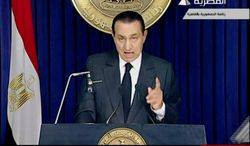 NOT GOING: Mr. Mubarak's decision to give power to the vice president was not enough for the thousands of demonstrators. (Associated Press)