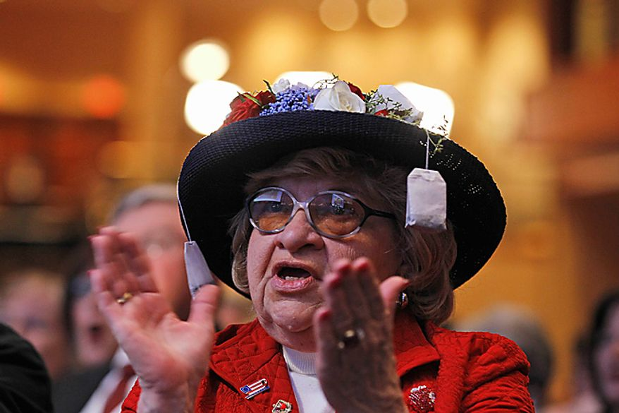 Martha Stamp of Wakefield, R.I., applauds as Rep. Michele Bachmann, Minnesota Republican, addresses the Conservative Political Action Conference (CPAC) in Washington on Thursday, Feb. 10, 2011. (AP Photo/Alex Brandon)