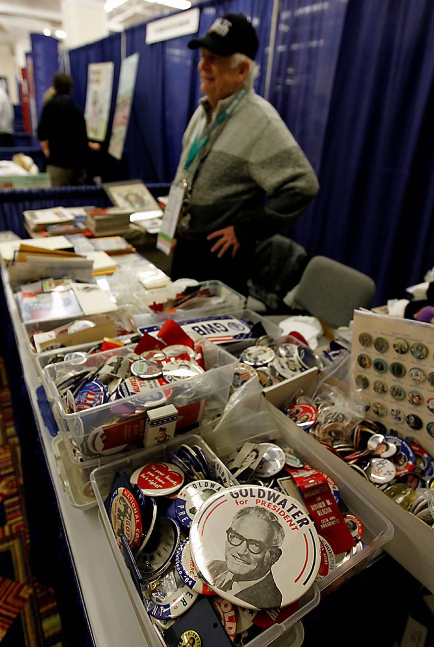 "Frank Enten of Bethesda, Md., sells political memorabilia, including a ""Goldwater for President"" button (foreground), at the Conservative Political Action Conference (CPAC) in Washington on Thursday, Feb. 10, 2011. (AP Photo/Alex Brandon)"