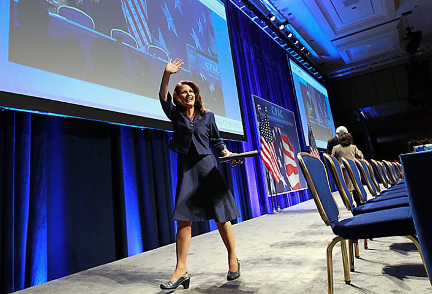 Rep. Michele Bachmann, Minnesota Republican, waves as she walks off the stage after speaking at the Conservative Political Action Conference (CPAC) in Washington on Thursday, Feb. 10, 2011. (AP Photo/Alex Brandon)