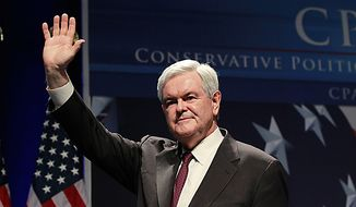 Former House Speaker Newt Gingrich waves after addressing the Conservative Political Action Conference (CPAC) in Washington on Thursday, Feb. 10, 2011. (AP Photo/Alex Brandon)