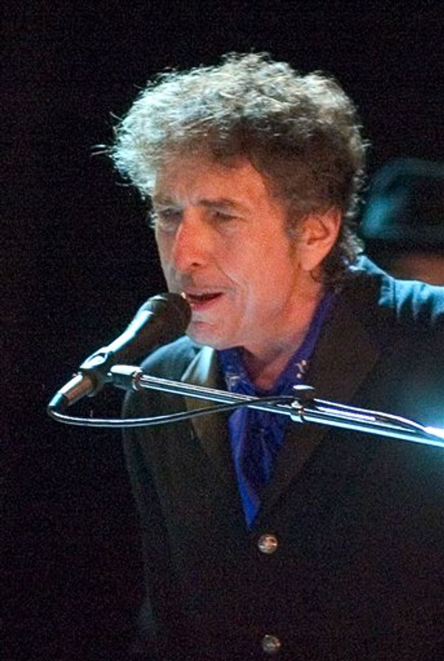 FILE - In this Aug. 26, 2006 file photo, Bob Dylan performs as the opening act of the Pawtucket Arts Festival at McCoy Stadium, in Pawtucket, R.I.    (AP Photo/Stew Milne, File)
