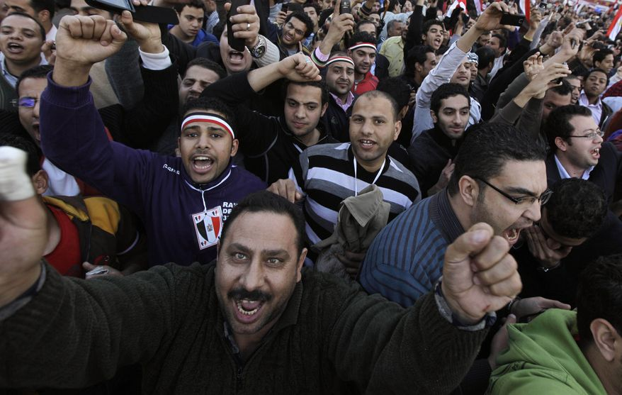 Cheering protesters react as high-ranking Egyptian Army Gen. Hassan El-Rueni, unseen, addresses the continuing anti-government demonstration in Tahrir Square in downtown Cairo, Egypt Thursday, Feb 10, 2011. (AP Photo/Ben Curtis)