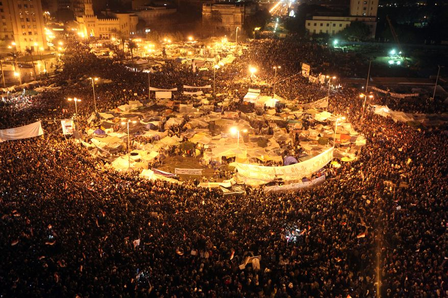 Anti-government protesters celebrate in Tahrir Square in downtown Cairo, Egypt, Thursday, Feb. 10, 2011. (AP Photo/Tara Todras-Whitehill)