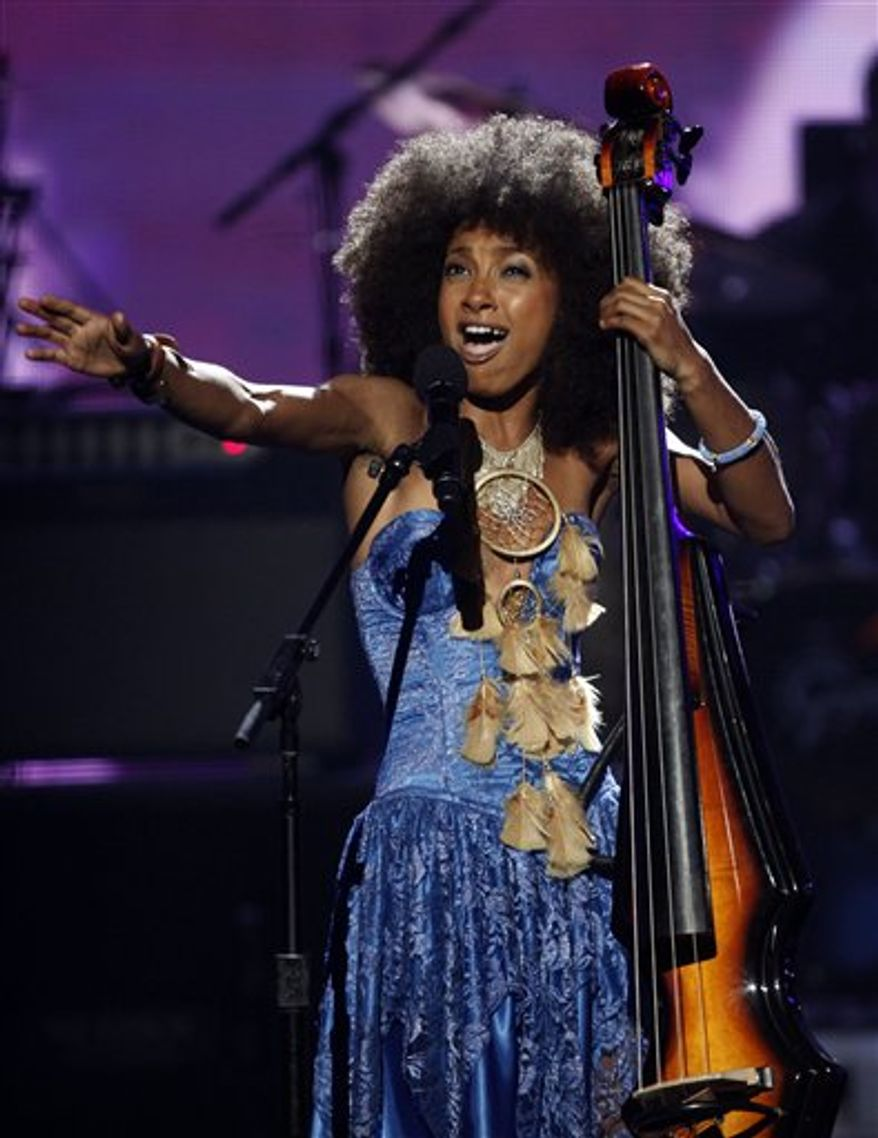 FILE - In this June 27, 2010 file photo, Esperanza Spalding performs at the BET Awards in Los Angeles.  (AP Photo/Matt Sayles, file)