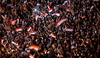 "Anti-government protesters celebrate in Tahrir Square in downtown Cairo, Egypt, Thursday, Feb. 10, 2011. Egypt's military announced on national television it had stepped in to secure the country and promised protesters calling for President Hosni Mubarak's ouster that all their demands would soon be met. Tens of thousands of protesters packed in central Tahrir broke into chants of ""We're almost there, we're almost there"" and waved V-for-victory signs as thousands more flowed in to join them well after nightfall. (AP Photo/Emilio Morenatti)"