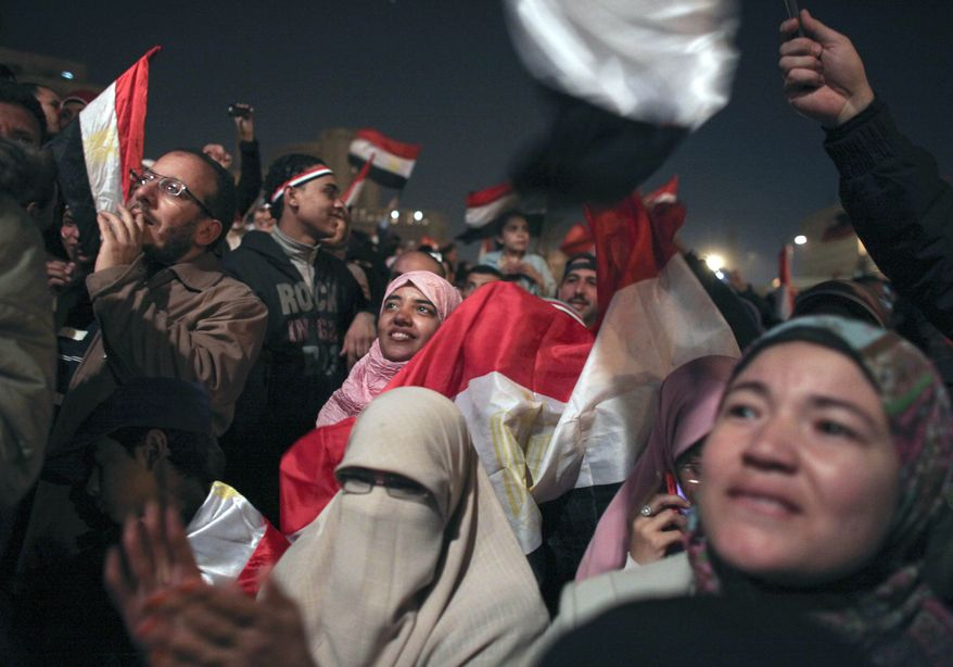 Egyptian women celebrate the news of the resignation of President Hosni Mubarak, who handed control of the country to the military, at night in Tahrir Square in downtown Cairo, Egypt, on Friday, Feb. 11, 2011. (AP Photo/Tara Todras-Whitehill)