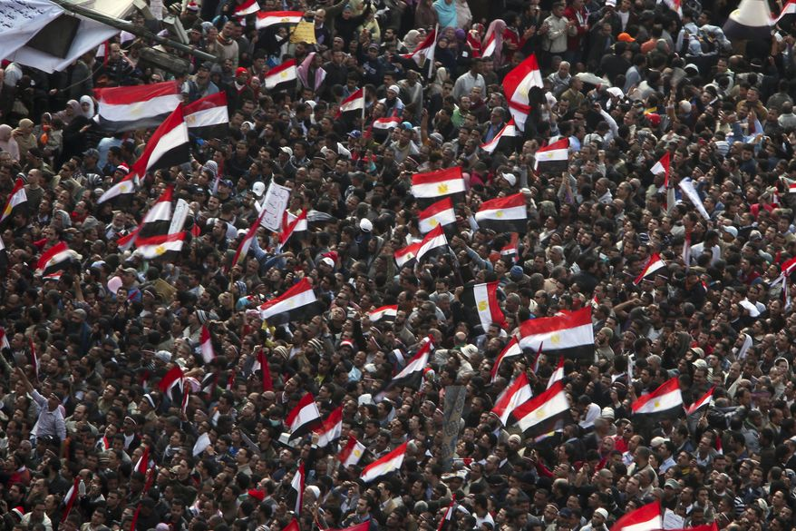 Anti-government protesters demonstrate after traditional Muslim Friday prayers at the continuing demonstration in Tahrir Square in downtown Cairo Friday, Feb. 11, 2011. (AP Photo/Tara Todras-Whitehill)