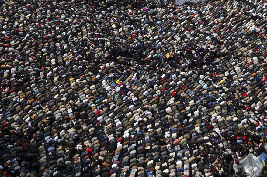 Anti-government protesters make traditional Muslim Friday prayers at the continuing demonstration in Tahrir Square in downtown Cairo, Egypt, on Friday, Feb. 11, 2011. (AP Photo/Tara Todras-Whitehill)