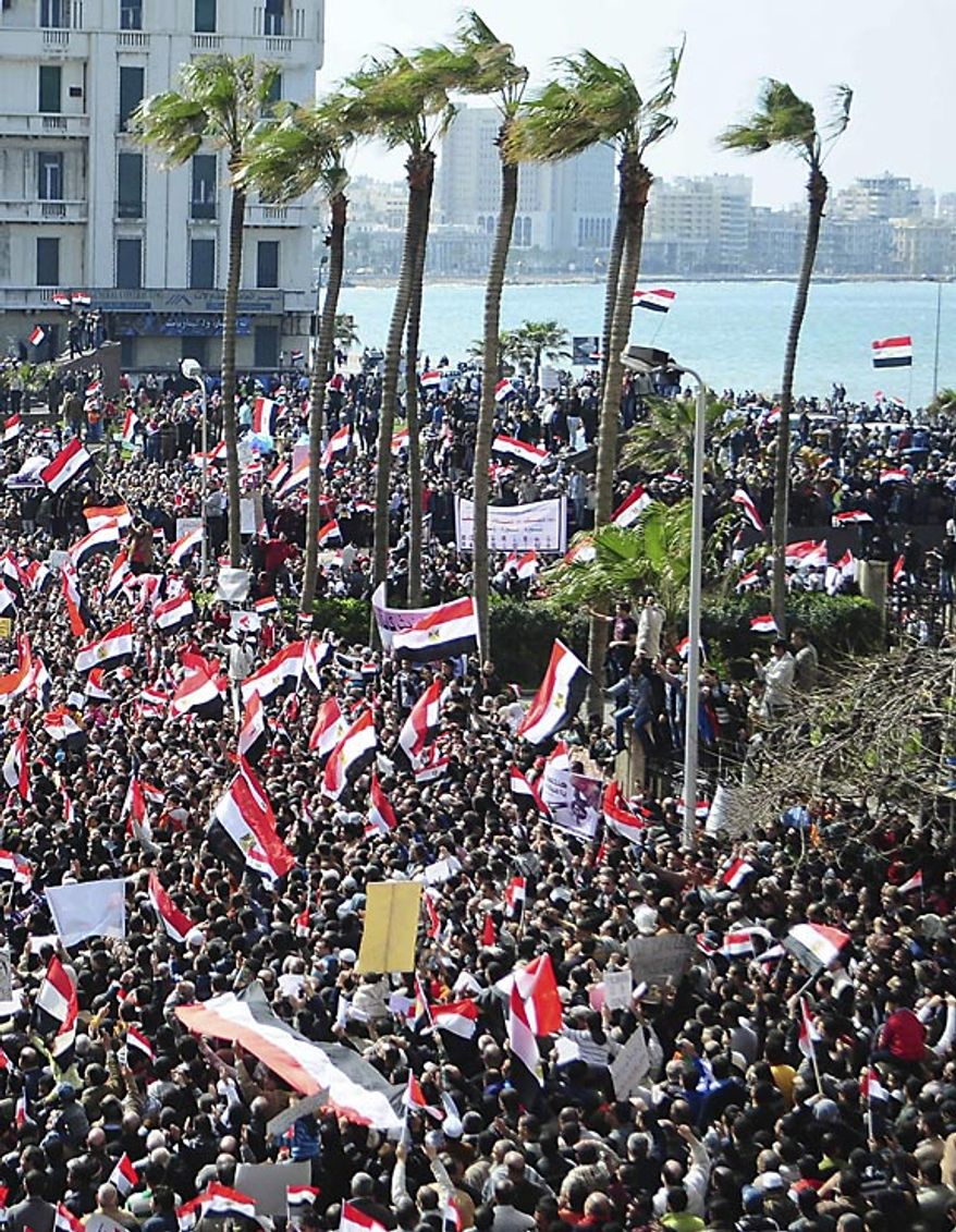 Thousands of Egyptian anti-government protesters march in Alexandria, Egypt, Friday, Feb. 11, 2011, hours before the government announced that President Hosni Mubarak has stepped down. (AP Photo/ Tarek Fawzy)