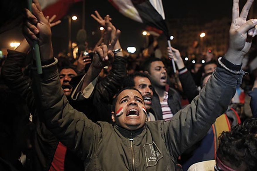 Anti-government protesters in Cairo's Tahrir Square react to Egyptian President Hosni Mubarak's televised statement to his nation Thursday, Feb. 10, 2011. Mr. Mubarak stepped down Friday. (AP Photo/Tara Todras-Whitehill)