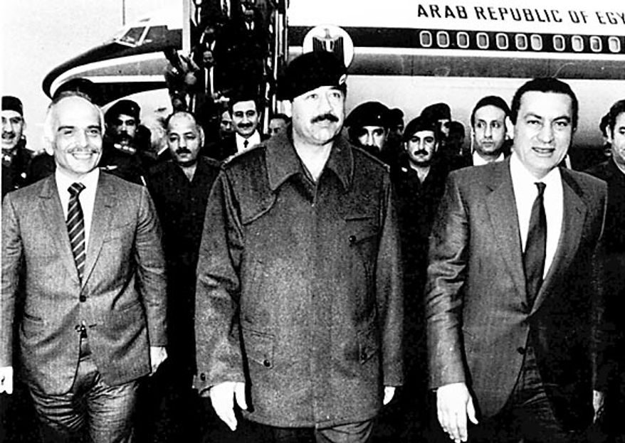 Iraqi President Saddam Hussein, center, welcomes Egyptian President Hosni Mubarak, right, and King Hussein of Jordan during a surprise visit to Baghdad on March 19, 1985. (AP Photo/File)