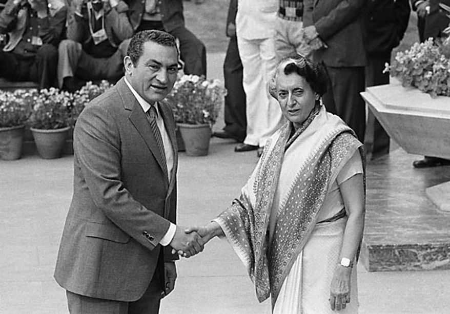 Egyptian President Hosni Mubarak, left, greets Indian Prime Minister Indira Gandhi on his arrival for the opening session of the 7th non-aligned summit, in New Delhi, India, on March 7, 1983. (AP Photo/File)