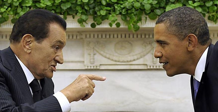 President Obama meets with Egyptian President Hosni Mubarak on Wednesday, Sept. 1, 2010, in the Oval Office of the White House in Washington. (AP Photo/Susan Walsh)