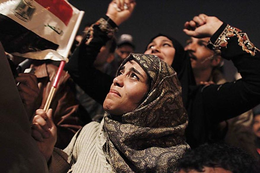 An Egyptian woman cries as she celebrates the news of the resignation of President Hosni Mubarak, who handed control of the country to the military, at night in Tahrir Square in downtown Cairo, Egypt Friday, Feb. 11, 2011. (AP Photo/Tara Todras-Whitehill)