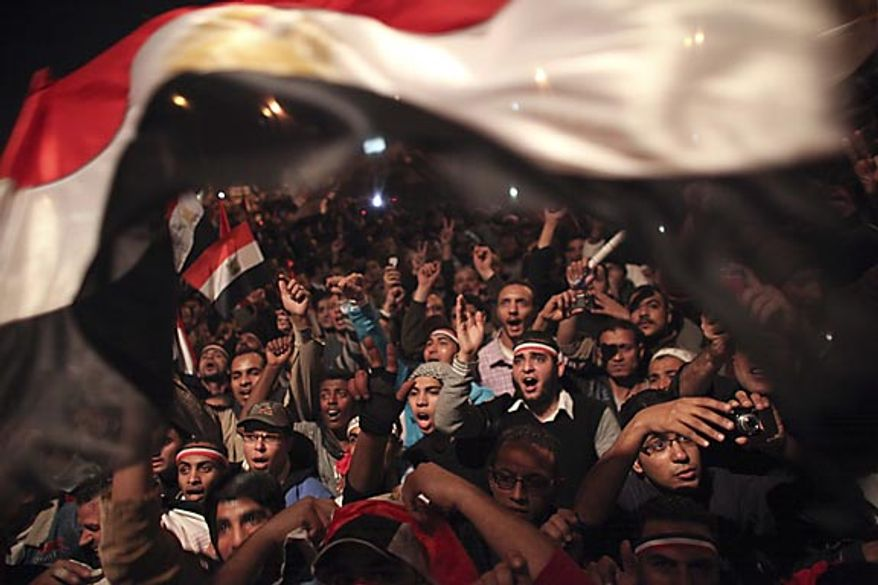 Egyptians celebrate the news of the resignation of President Hosni Mubarak, who handed control of the country to the military, at night in Tahrir Square in Cairo, Egypt, Friday, Feb. 11, 2011. (AP Photo/Tara Todras-Whitehill)