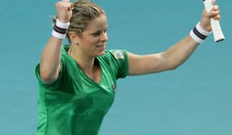 Belgium's Kim Clijsters reacts after defeating Estonia's Kaia Kanepi during their semifinal of the Paris Open tennis tournament at Coubertin stadium in Paris, Friday, Feb. 12, 2011. (AP Photo/ Yoan Valat)