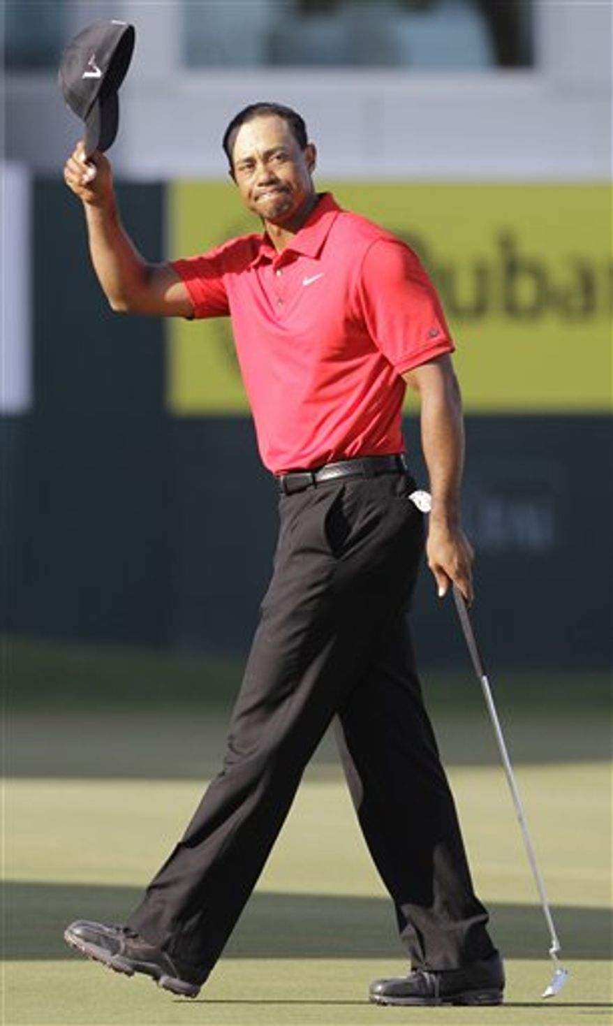 Tiger Woods from U.S. reacts after he finishes on the 18th hole during the final round of Dubai Desert Classic golf tournament at the Emirates Golf Club in Dubai, United Arab Emirates, Sunday Feb. 13, 2011. (AP Photo/Kamran Jebreili)