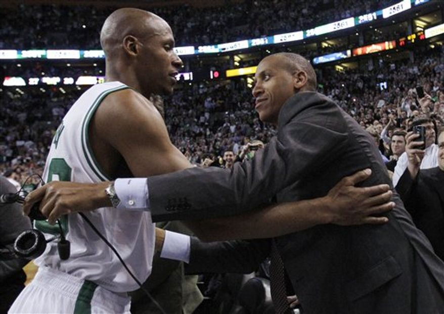 Boston Celtics Ray Allen celebrates after hitting a 3-point basket against the Los Angeles Lakers during the first quarter of an NBA basketball game in Boston on Thursday, Feb. 10, 2011. The shot moved Allen ahead of Reggie Miller into first place on the career list for 3-point baskets. (AP Photo/Elise Amendola)