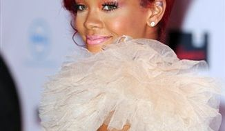 FILE - This Nov. 7, 2010, file photo shows Rihanna arriving for the MTV European Music Awards 2010, in Madrid. Rihanna and Lenny Kravitz headline the entertainment lineup for the NBA All-Star game, the league revealed Wednesday, Feb. 9, 2011. (AP Photo/Dave Fisher, File)
