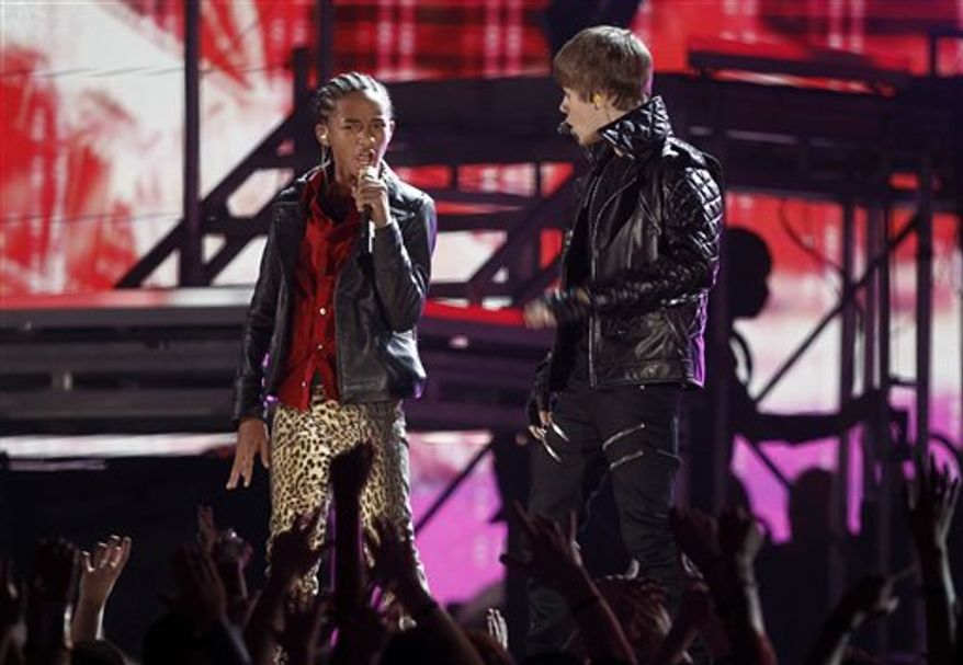 Jaden Smith, left, and Justin Bieber perform at the 53rd annual Grammy Awards on Sunday, Feb. 13, 2011, in Los Angeles. (AP Photo/Matt Sayles)