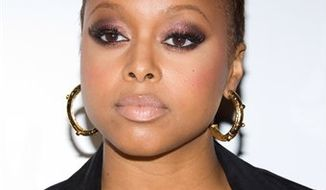 """FILE - Singer Chrisette Michele attends her album release party at Mansion in New York, in this May 12, 2009 file photo. Michele, crooned """"Unforgettable"""" as a tribute to jazz's influence on hip-hop at Thursday Feb. 11, 2011 at """"Word Revolution: A Celebration of the Evolution of Hip-Hop,"""" part of the Grammy Foundation's 13th annual music preservation project. (AP Photo/Charles Sykes, File)"""