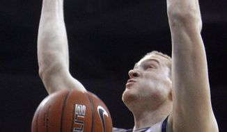 Georgetown forward Nate Lubick (34) dunks against Marquette during the first half of a men's NCAA college basketball game in Washington, on Sunday, Feb. 13, 2011. (AP Photo/Jacquelyn Martin)