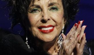 FILE- In this Sept. 27, 2007 file photo, actress Elizabeth Taylor is shown at the Macy's Passport 2007 charity benefit in Santa Monica, Calif. Taylor has entered her second month at Cedars-Sinai Medical Center in Los Angeles, where she is being treated for symptoms of congestive heart failure. Publicist Jamie Cadwell said Tuesday, March 15, 2011 that the 79-year-old actress remains hospitalized after she was admitted to Cedars-Sinai in early February. (AP Photo/Dan Steinberg, File)