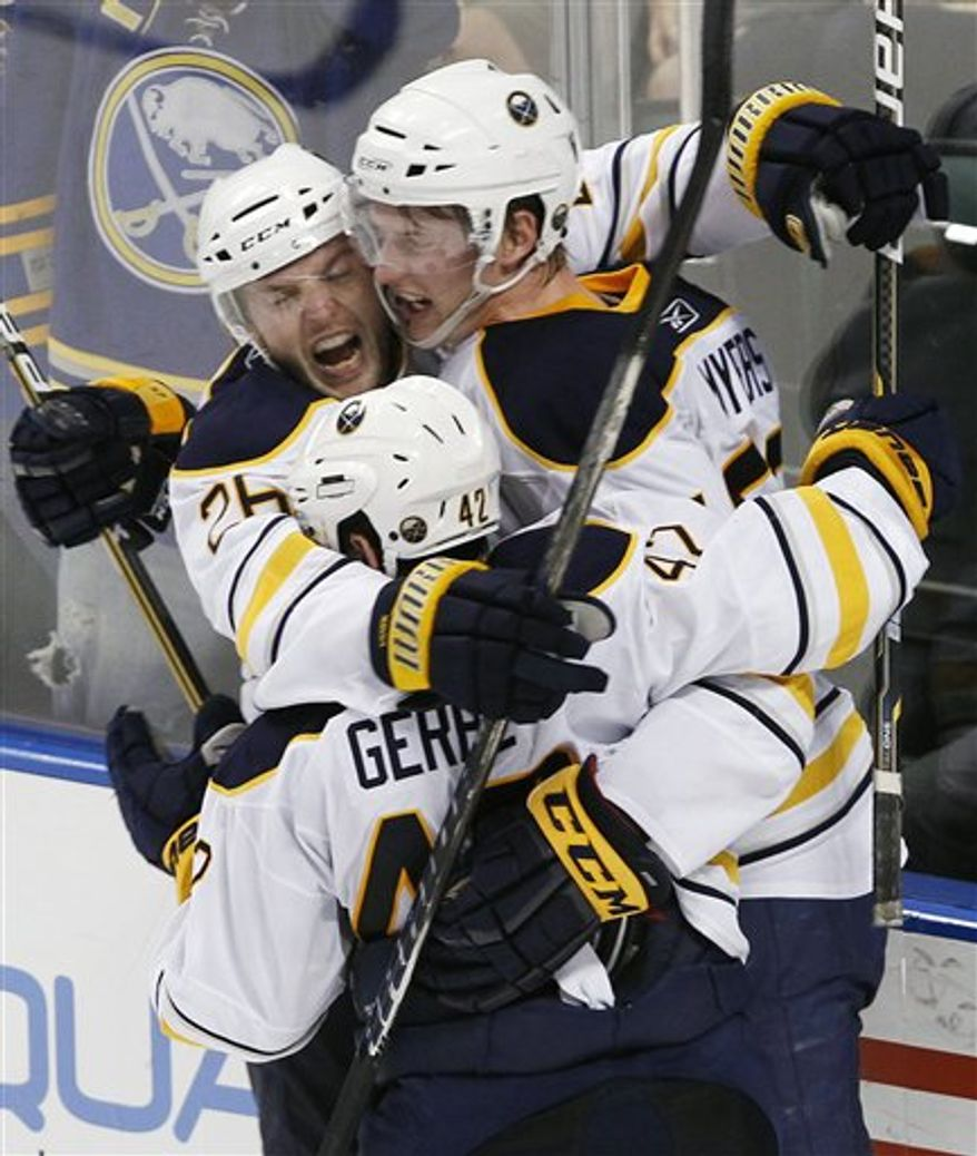 Buffalo Sabres left wings Thomas Vanek, left, and Nathan Gerbe, foreground, hug defenseman Tyler Myers after Myers scored the winning goal during an overtime period of an NHL hockey game against the Florida Panthers, Thursday, Feb. 10, 2011, in Sunrise, Fla. The Sabres defeated the Panthers 3-2. (AP Photo/Wilfredo Lee)