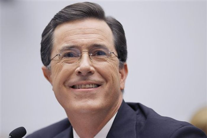 """FILE - In this Sept. 24, 2010 file photo, TV personality Stephen Colbert, host of """"The Colbert Report,"""" testifies on Capitol Hill in Washington before the House Immigration, Citizenship, Refugees, Border Security and International Law subcommittee hearing on Protecting America's Harvest. (AP Photo/Alex Brandon, file)"""