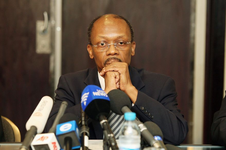 Mr. Aristide, at a Jan. 15 press conference in Johannesburg, South Africa, said he was ready to return to his quake-devastated country, but he did not say when or how. The former Haitian president currently lives in exile in South Africa. (Associated Press)