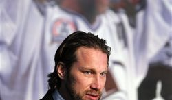 Colorado Avalanche Swedish forward Peter Forsberg with tears in his eyes announces his retirement from hockey during a news conference, Monday, Feb. 14, 2011, in Denver. Forsberg announced his retirement two games after returning to the NHL after a three-year absence. (AP Photo/ Ed Andrieski)