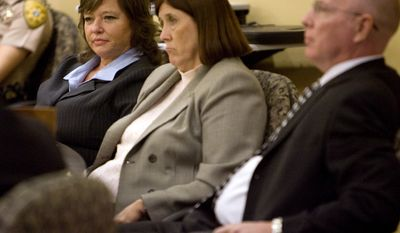 Shawna Forde (far left) sits at the defense table with her lawyers, Jill Thorpe and Eric Larsen, during closing arguments in her trial in Pima County Superior Court in Tucson, Ariz., on Thursday, Feb. 10, 2011. A jury on Monday found Forde guilty in the May 2009 killings of 29-year-old Raul Flores and his 9-year-old daughter, Brisenia, at their home in Arivaca, a desert community about 10 miles north of the Mexican border. (AP Photo/Arizona Daily Star, Mamta Popat)