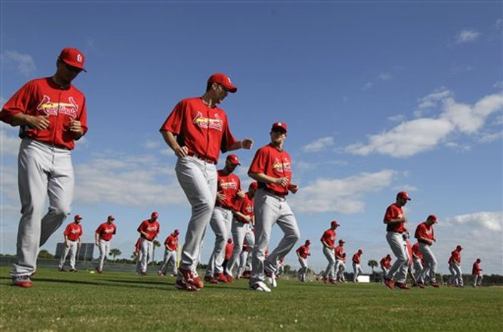 St. Louis Cardinals manager Tony La Russa looks on during baseball spring training on Sunday, Feb. 20, 2011, in Jupiter, Fla. (AP Photo/Jeff Roberson)