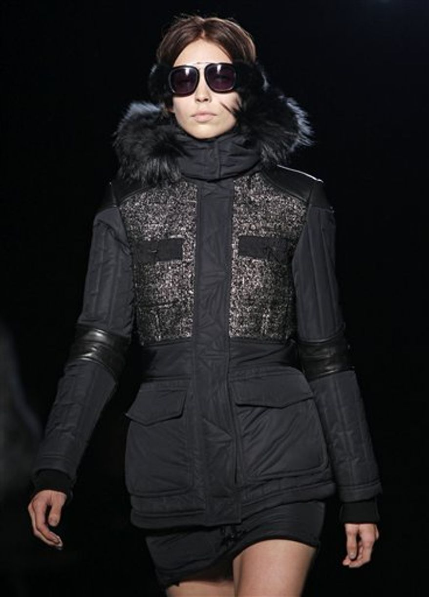 A model walks the runway at the Alexander Wang Fall 2011 show at Pier 94 in New York, Saturday, Feb. 12, 2011.  (AP Photo/Kathy Willens)