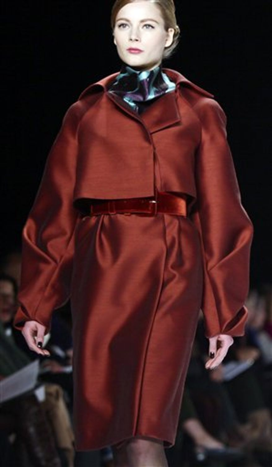 Fashion from the Fall 2011 collection of Carolina Herrera is modeled on Monday, Feb. 14, 2011 in New York.  (AP Photo/Bebeto Matthews)