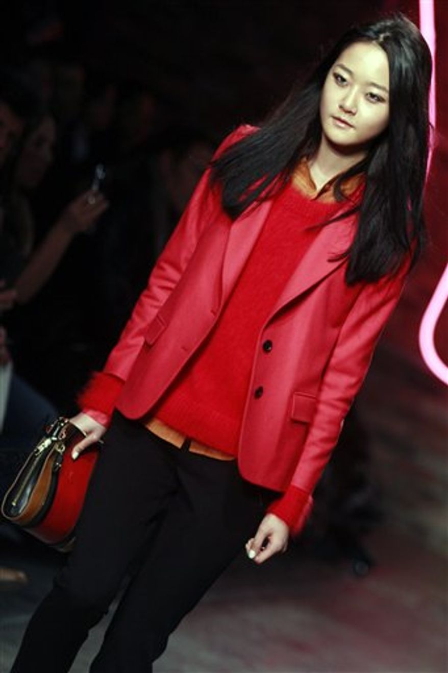 Fashion from the Fall 2011 collection of Donna Karan's DKNY is modeled on Sunday, Feb. 13, 2011 in New York.  (AP Photo/Bebeto Matthews)