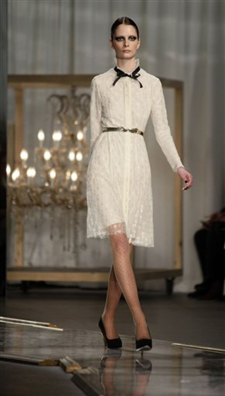 Fashion from the Fall 2011 collection of Jason Wu is modeled on Friday, Feb. 11, 2011 in New York.   (AP Photo/Bebeto Matthews)
