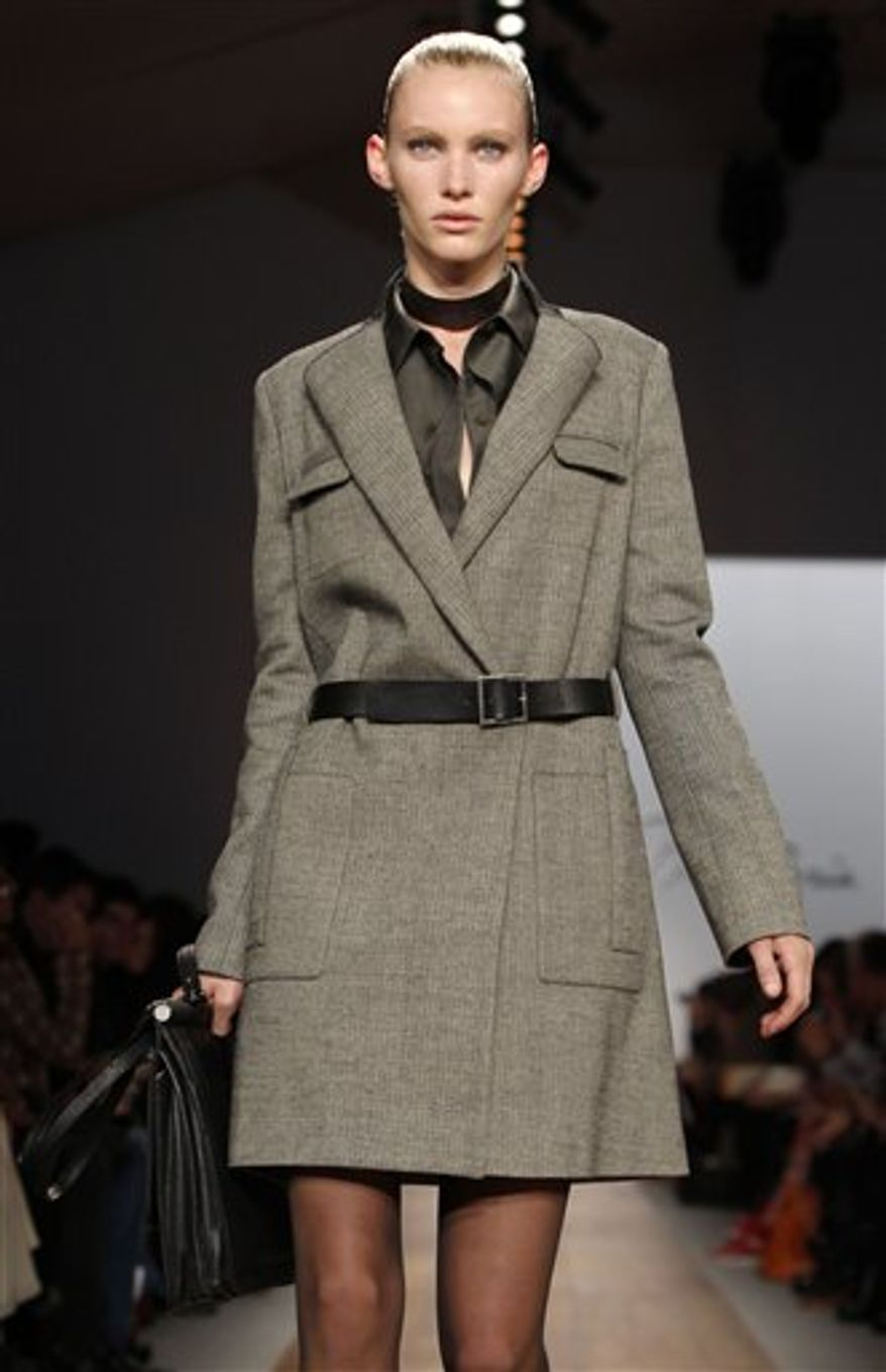A model walks the runway at the Max Azria Fall 2011 show at Lincoln Center in New York, Sunday, Feb. 13, 2011.  (AP Photo/Kathy Willens)