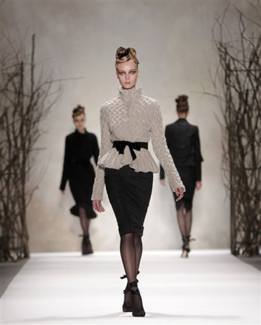 Fall 2011 fashion from Monique Lhuillier is modeled during Fashion Week in New York, Monday, Feb. 14, 2011.  (AP Photo/Seth Wenig)