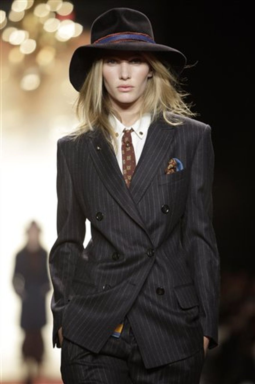 A model walks the runway at the Tommy Hilfiger Fall 2011 show during Fashion Week at Lincoln Center in New York, Sunday, Feb. 13, 2011.  (AP Photo/Kathy Willens)