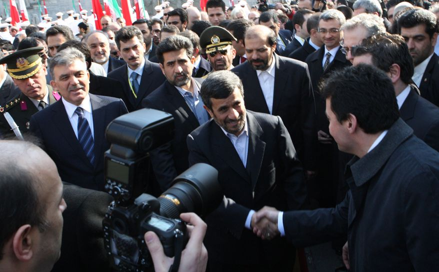 Iranian President Mahmoud Ahmadinejad, center, greets the Turkish delegation as his Turkish counterpart Abdullah Gul, second left, looks on, during an official welcoming ceremony for him, in Tehran Monday, Feb. 14, 2011. (AP Photo/Vahid Salemi)