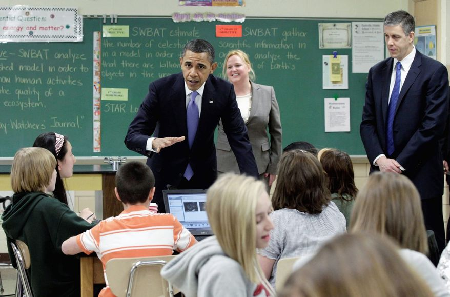 EDUCATION INITIATIVE: President Obama visits teacher Susan Yoder's science class at Parkville Middle School and Center of Technology in Parkville, Md., on Monday. Mr. Obama's $3.7 trillion fiscal 2012 budget boosts overall education spending by 11 percent. (Associated Press)