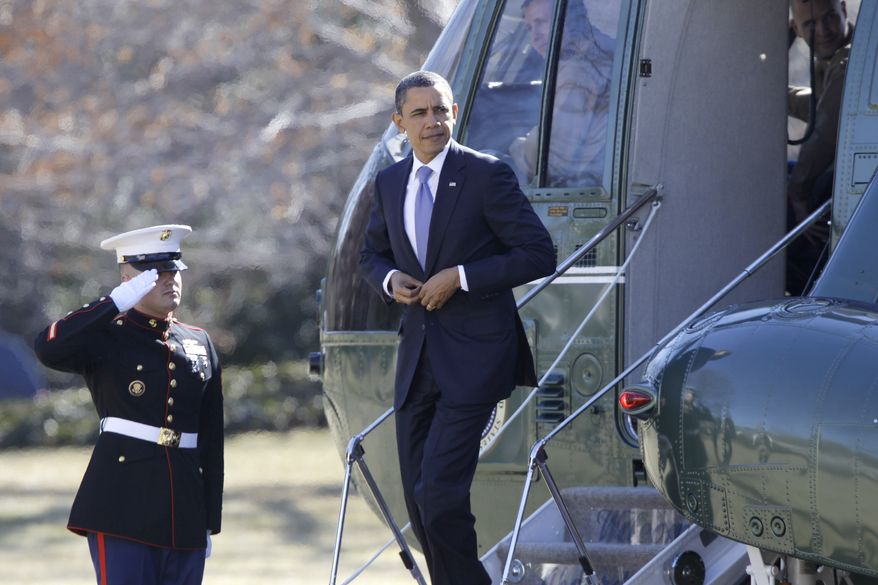 President Barack Obama steps off Marine One helicopter on the South Lawn of the White House in Washington as he returns from Baltimore, Md., Monday, Feb. 14, 2011. (AP Photo/Charles Dharapak)