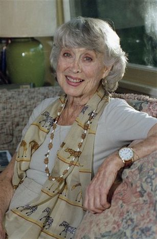"FILE - Actress Betty Garrett poses at her home in Los Angeles on in this Dec. 16, 1997 file photo. Garrett, who played Frank Sinatra's sweetheart in two MGM musicals before her career was hampered by the Hollywood blacklist, died Saturday Feb. 12, 2011 in Los Angeles. Later in life she became well-known to TV audiences with recurring roles in the 1970s sitcoms ""All in the the Family"" and Laverne and Shirley. She was 91. (AP Photo/Mark J. Terrill, File)"